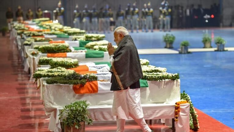 Indian PM Narendra Modi paying his respects to the martyrs